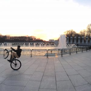 At the WWII monument - just happened to capture this kid wheely-ing around the whole thing.  Skills!