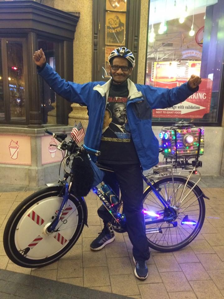 Happened across this guy elsewhere in DC; one man bike party!